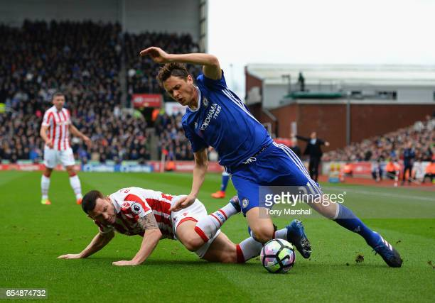 Phil Bardsley of Stoke City tackles Nemanja Matic of Chelsea during the Premier League match between Stoke City and Chelsea at Bet365 Stadium on...