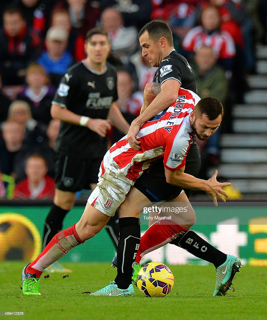 Phil Bardsley of Stoke City tangles with Dean Marney of Burnley during the Barclays Premier League match between Stoke City and Burnley at the Britannia Stadium on November 22, 2014 in Stoke on Trent, England.