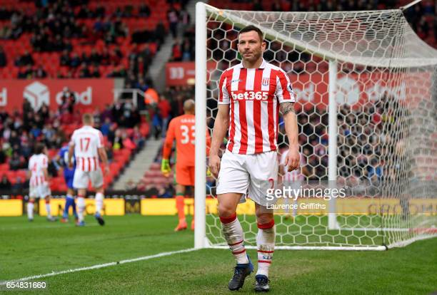 Phil Bardsley of Stoke City walks off after being sent off during the Premier League match between Stoke City and Chelsea at Bet365 Stadium on March...