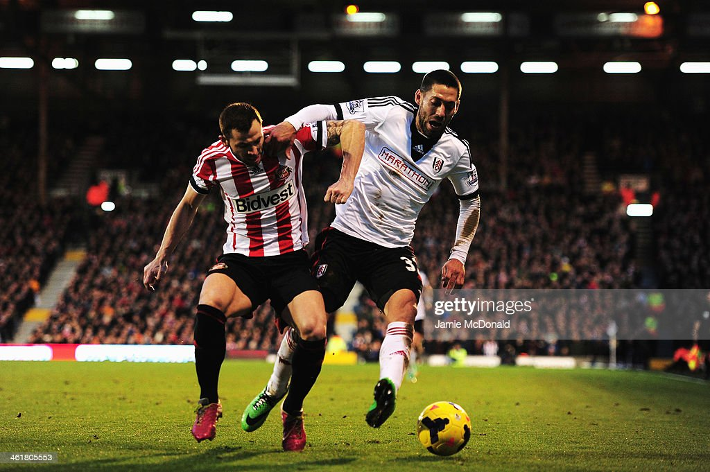 Phil Bardsley of Sunderland and Clint Dempsey of Fulham challenge for the ball during the Barclays Premier League match between Fulham and Sunderland at Craven Cottage on January 11, 2014 in London, England.