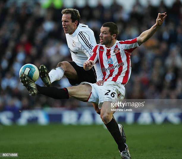 Phil Bardsley of Sunderland and Eddie Lewis of Derby County challenge for the ball during the Barclays Premier League match between Derby and...