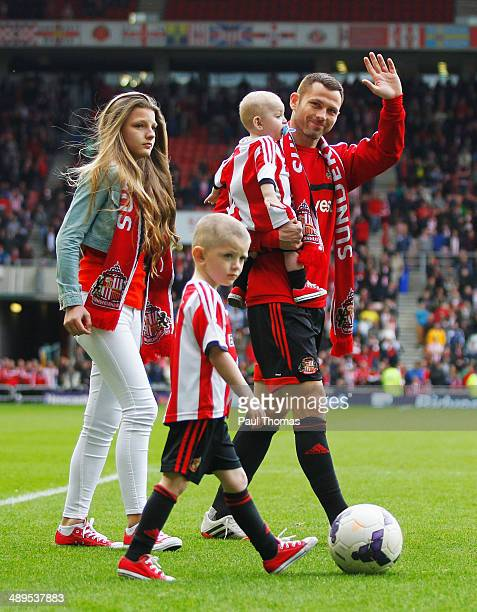 Phil Bardsley of Sunderland and his familky enjoy a lap of honour after the Barclays Premier League match between Sunderland and Swansea City at...