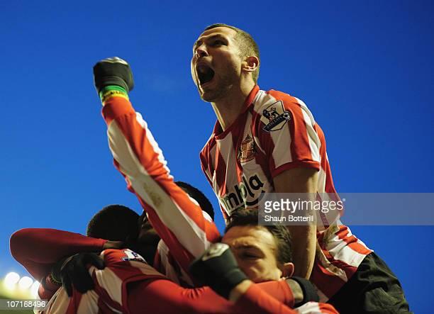 Phil Bardsley of Sunderland celebrates after team-mate Darren Bent scores during the Barclays Premier League match between Wolverhampton Wanderers...