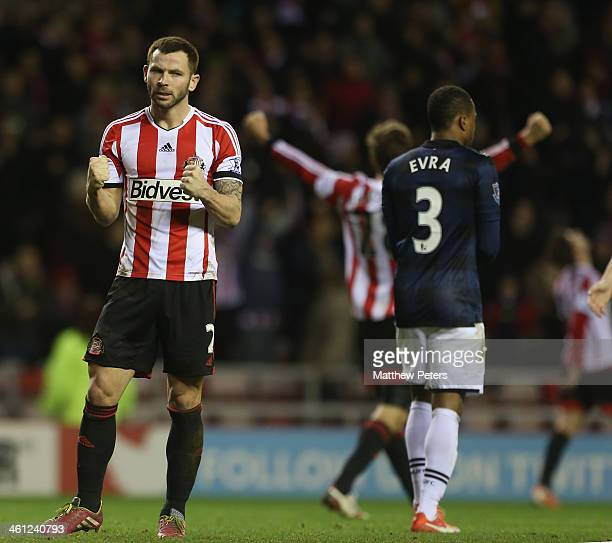 Phil Bardsley of Sunderland celebrates after the Capital One Cup SemiFinal first leg between Sunderland and Manchester United at Stadium of Light on...