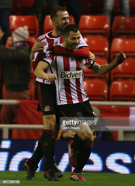 Phil Bardsley of Sunderland celebrates Ryan Giggs of Manchester United scoring an owngoal during the Capital One Cup SemiFinal first leg between...