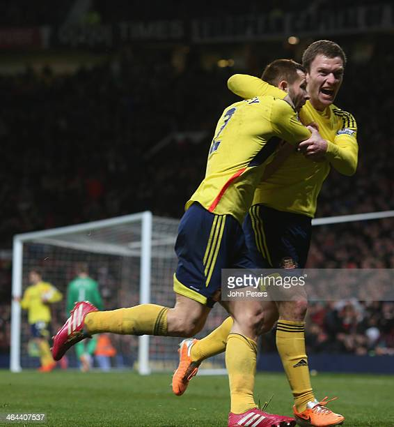 Phil Bardsley of Sunderland celebrates scoring their first goal during the Capital One Cup semifinal second leg at Old Trafford on January 22 2014 in...