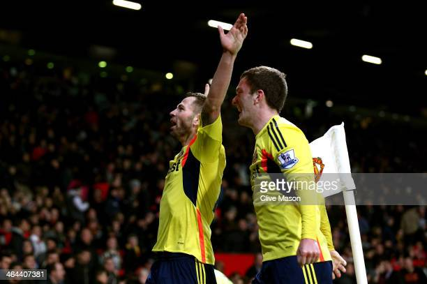 Phil Bardsley of Sunderland celebrates with teammate Craig Gardner after scoring his team's goal during the Capital One Cup semi final second leg...
