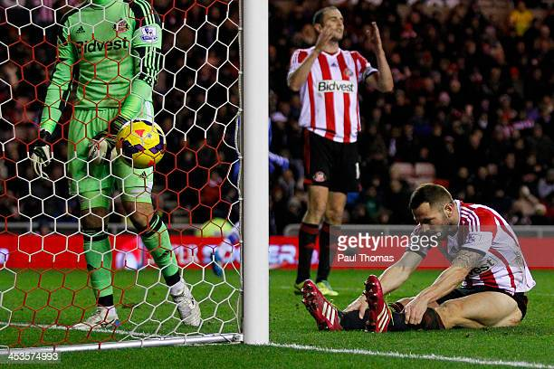 Phil Bardsley of Sunderland reacts after scoring an own goal during the Barclays Premier League match between Sunderland and Chelsea at the Stadium...
