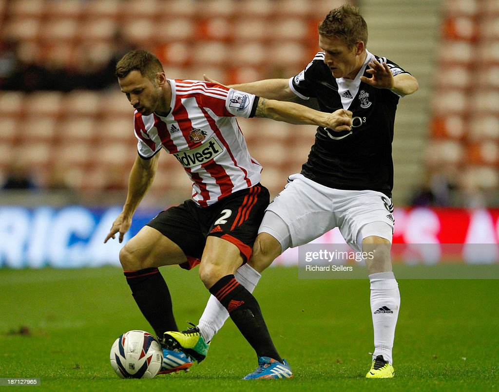 Phil Bardsley (L) of Sunderland vies with Stephen Davis of Southampton during the Capital One Cup fourth Round match between Sunderland and Southampton at Stadium of Light on November 06, 2013 in Sunderland, England.