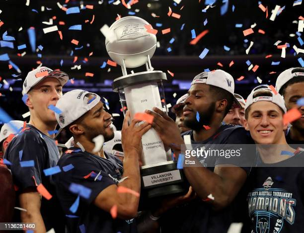 Phil Booth and Paschall of Villanova Wildcats celebrate the 7472 win over the Seton Hall Pirates to take the Big East Championship title at Madison...