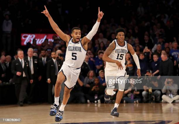 Phil Booth and Saddiq Bey of the Villanova Wildcats celebrate the win of the Big East Championship Game after defeated Seton Hall Pirates 7472 at...
