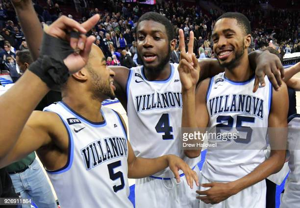 Phil Booth Eric Paschall and Mikal Bridges of the Villanova Wildcats celebrate after the game against the Georgetown Hoyas at Wells Fargo Center on...