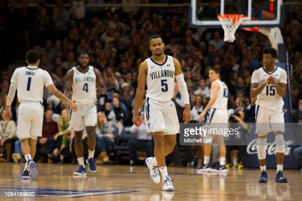Phil Booth Jahvon Quinerly Eric Paschall Cole Swider and Saddiq Bey of the Villanova Wildcats in action against the St John's Red Storm at Finneran...