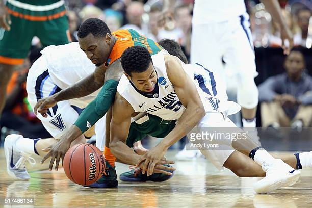Phil Booth of the Villanova Wildcats and Sheldon McClellan of the Miami Hurricanes battle for a loose ball during the 2016 NCAA Men's Basketball...