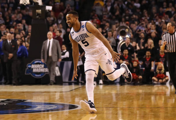 Phil Booth of the Villanova Wildcats celebrates defeating the Texas Tech Red Raiders 7159 in the 2018 NCAA Men's Basketball Tournament East Regional...