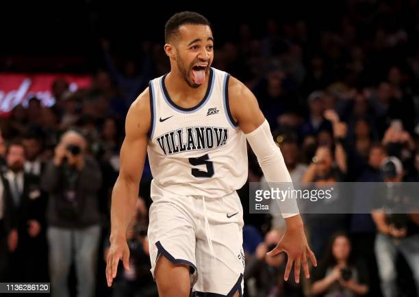 Phil Booth of the Villanova Wildcats celebrates the 7472 win over the Seton Hall Pirates during the Big East Championship Game at Madison Square...