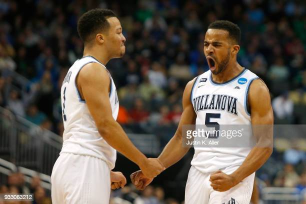 Phil Booth of the Villanova Wildcats celebrates with teammate Jalen Brunson after a basket against the Alabama Crimson Tide during the second half in...
