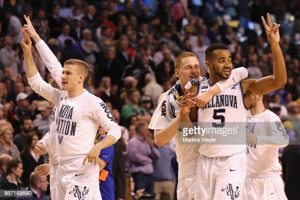 Phil Booth of the Villanova Wildcats celebrates with teammates after defeating the West Virginia Mountaineers 9078 in the 2018 NCAA Men's Basketball...