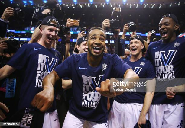 Phil Booth of the Villanova Wildcats celebrates with teammates after defeating the Texas Tech Red Raiders 7159 in the 2018 NCAA Men's Basketball...