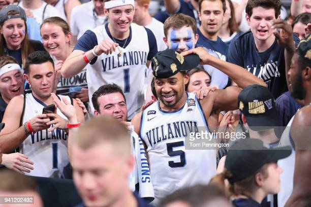 Phil Booth of the Villanova Wildcats celebrates with teammates after defeating the Michigan Wolverines during the 2018 NCAA Men's Final Four National...