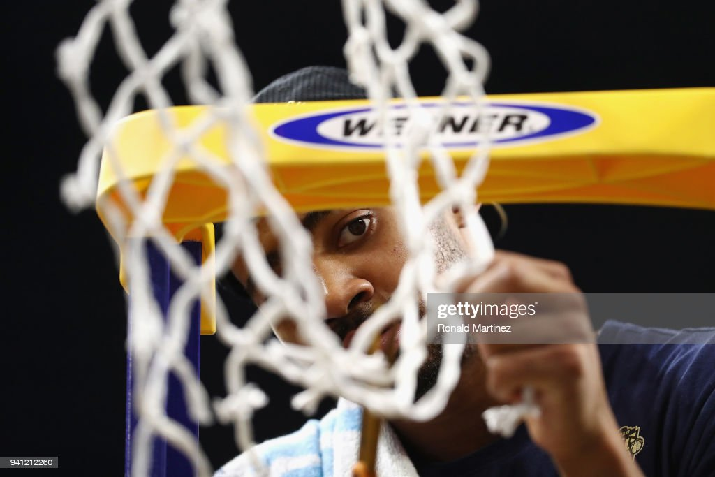 Phil Booth #5 of the Villanova Wildcats cuts down the net after defeating the Michigan Wolverines during the 2018 NCAA Men's Final Four National Championship game at the Alamodome on April 2, 2018 in San Antonio, Texas. Villanova defeated Michigan 79-62.