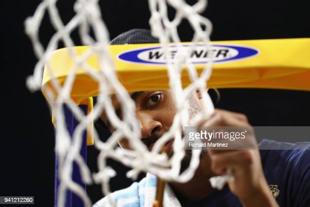 Phil Booth of the Villanova Wildcats cuts down the net after defeating the Michigan Wolverines during the 2018 NCAA Men's Final Four National...
