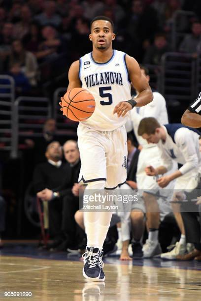Phil Booth of the Villanova Wildcats dribbles up court during a college basketball game against the Xavier Musketeers at Wells Fargo Arena on January...