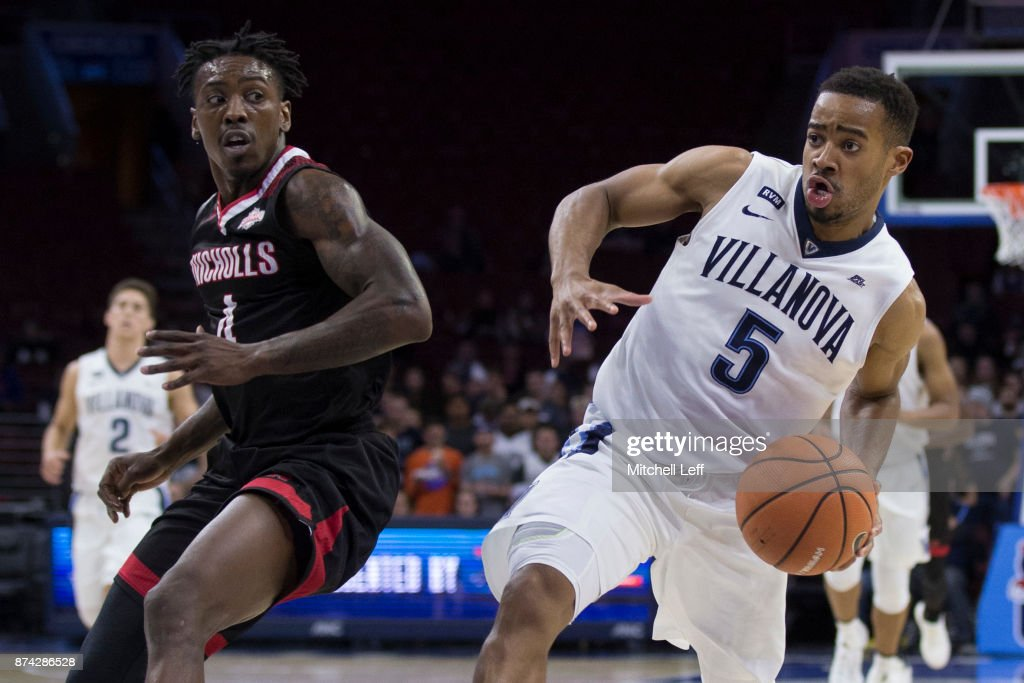 Phil Booth #5 of the Villanova Wildcats drives to the basket against Zaquavian Smith #4 of the Nicholls State Colonels in the second half at the Wells Fargo Center on November 14, 2017 in Philadelphia, Pennsylvania. The Villanova Wildcats defeated the Nicholls State Colonels 113-77.