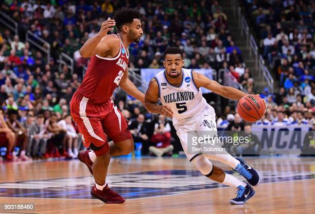 Phil Booth of the Villanova Wildcats drives to the basket against Braxton Key of the Alabama Crimson Tide in the second half during the game in the...