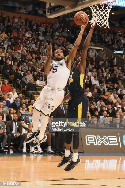 Phil Booth of the Villanova Wildcats drives to the basket over Wesley Harris of the West Virginia Mountaineers during the 2018 NCAA Men's Basketball...