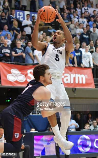 Phil Booth of the Villanova Wildcats gets fouled by Jackson Donahue of the Pennsylvania Quakers at Jake Nevin Field House on November 29 2017 in...