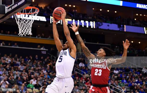 Phil Booth of the Villanova Wildcats goes to the basket for a slam dunk against John Petty of the Alabama Crimson Tide in the second half during the...