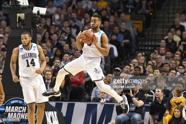 Phil Booth of the Villanova Wildcats grabs a loose ball during the 2018 NCAA Men's Basketball Tournament East Regional against the West Virginia...