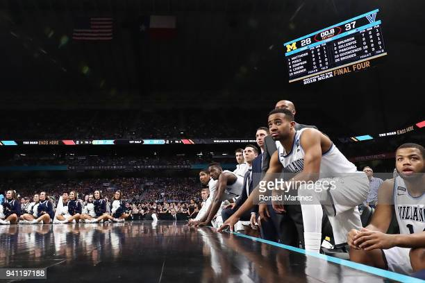Phil Booth of the Villanova Wildcats looks on with teammates in the first half against the Michigan Wolverines during the 2018 NCAA Men's Final Four...