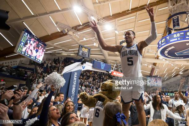 Phil Booth of the Villanova Wildcats salutes the student section after the game against the Marquette Golden Eagles at Finneran Pavilion on February...
