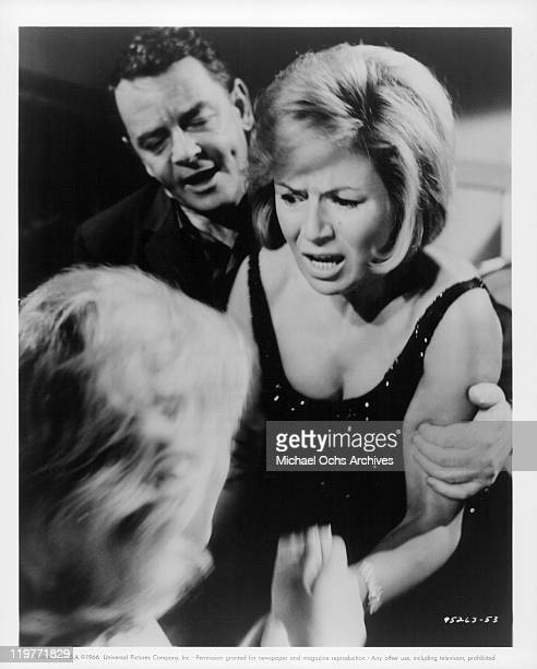 Phil Brown and Veronica Hurst beg Beba Loncar to tell them where their son is in a scene from the film 'The Boy Cried Murder' 1966