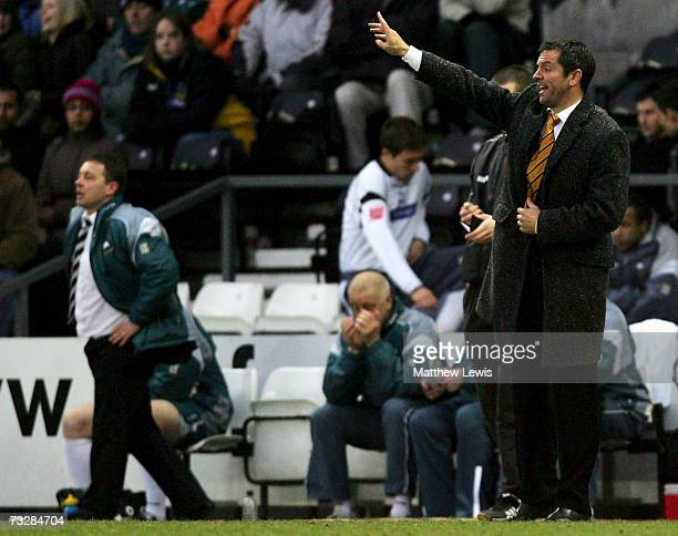 Phil Brown manager of Hull City gives out instructions as Billy Davies manager of Derby County looks on during the CocaCola Championship match...