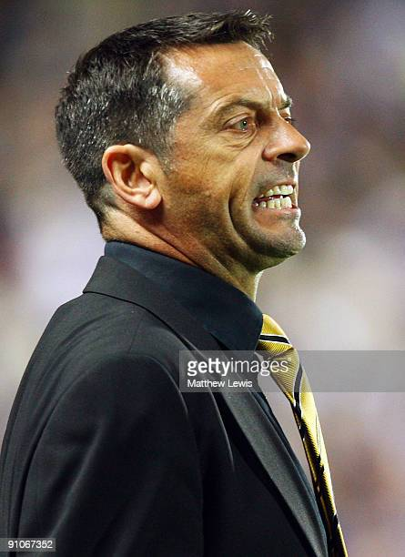 Phil Brown manager of Hull City shows his frustration during the Carling Cup Third Round match between Hull City and Everton at the KC Stadium on...
