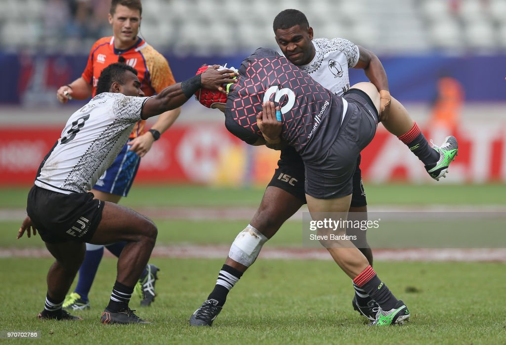 Phil Burgess of England is tackled by Vatemo Ravouvou of Fiji during the Cup quarter final match between Fiji and England during the HSBC Paris Sevens at Stade Jean Bouin on June 10, 2018 in Paris, France.