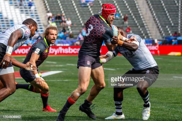 Phil Burgess of England tackled by Fiji player in Match Fiji vs England during the LA Sevens Round 5 of the HSBC World Rugby Sevens Series held March...