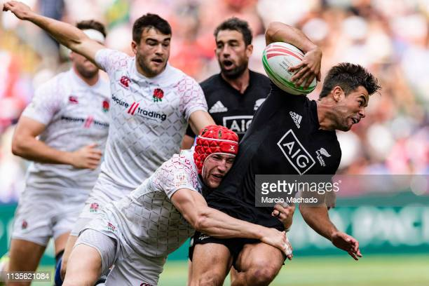 Phil Burgess of England tries to put a tackle on Andrew Knewstubb of New Zealand during the day three of the Cathay Pacific/HSBC Hong Kong Sevens...