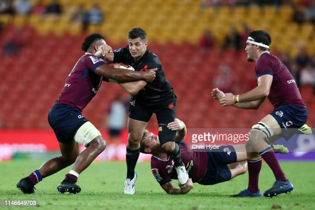Phil Burleigh of the Sunwolves is tackled during the round 12 Super Rugby match between the Reds and the Sunwolves at Suncorp Stadium on May 03 2019...