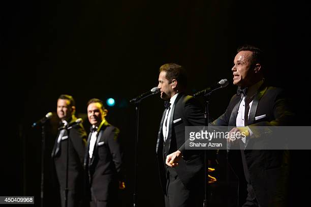 Phil Burton, Andrew Tierney, Michael Tierney and Toby Allen of Human Nature perform on stage during the Apollo Spring Gala and 80th Anniversary...