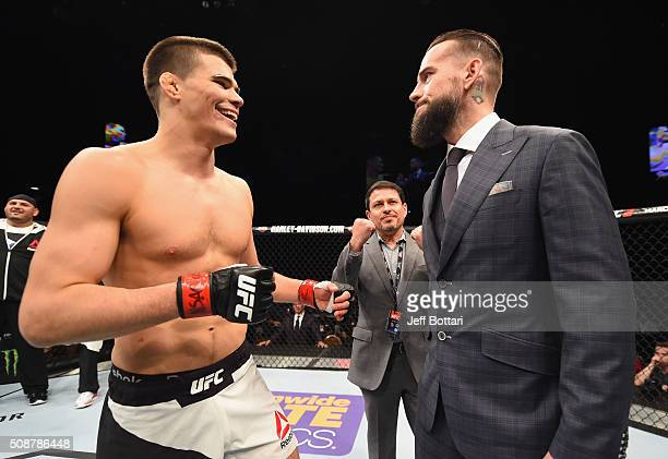 Phil 'CM Punk' Brooks faces off with Mickey Gall after Gall's victory over Mike Jackson during the UFC Fight Night event at MGM Grand Garden Arena on...