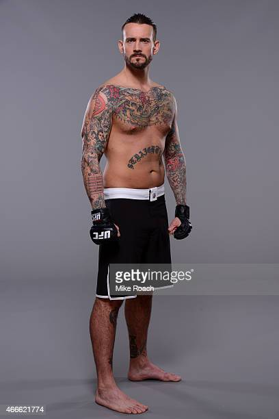 Phil CM Punk Brooks poses for a photo during a UFC photo session at the Hilton Anatole Hotel on March 13 2015 in Dallas Texas