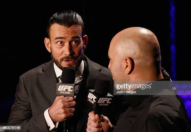 Phil 'CM Punk' Brooks speaks with Joe Rogan during the UFC 181 event inside the Mandalay Bay Events Center on December 6 2014 in Las Vegas Nevada