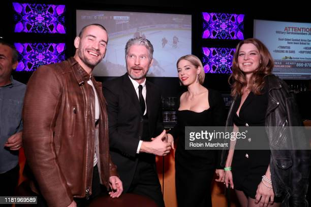 Phil 'CM Punk' Brooks Travis Stevens Sarah Lind and Sarah Brooks attend the red carpet premiere of Girl On The Third Floor at the Chicago...