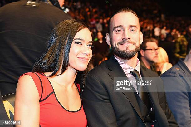 Phil 'CM Punk' Brooks with wife AJ Lee attends UFC 182 event at the MGM Grand Garden Arena on January 3 2015 in Las Vegas Nevada