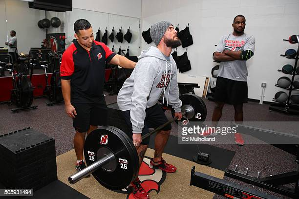 Phil 'CM Punk' Brooks works out at the New Jersey Devils facility with New Jersey Devils assistant strength and conditioning coach Jaime Rodriguez at...