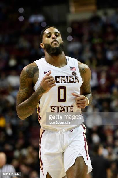Phil Cofer forward Florida State University Seminoles hustles down the court after scoring against the Miami Hurricanes in an Atlantic Coast...